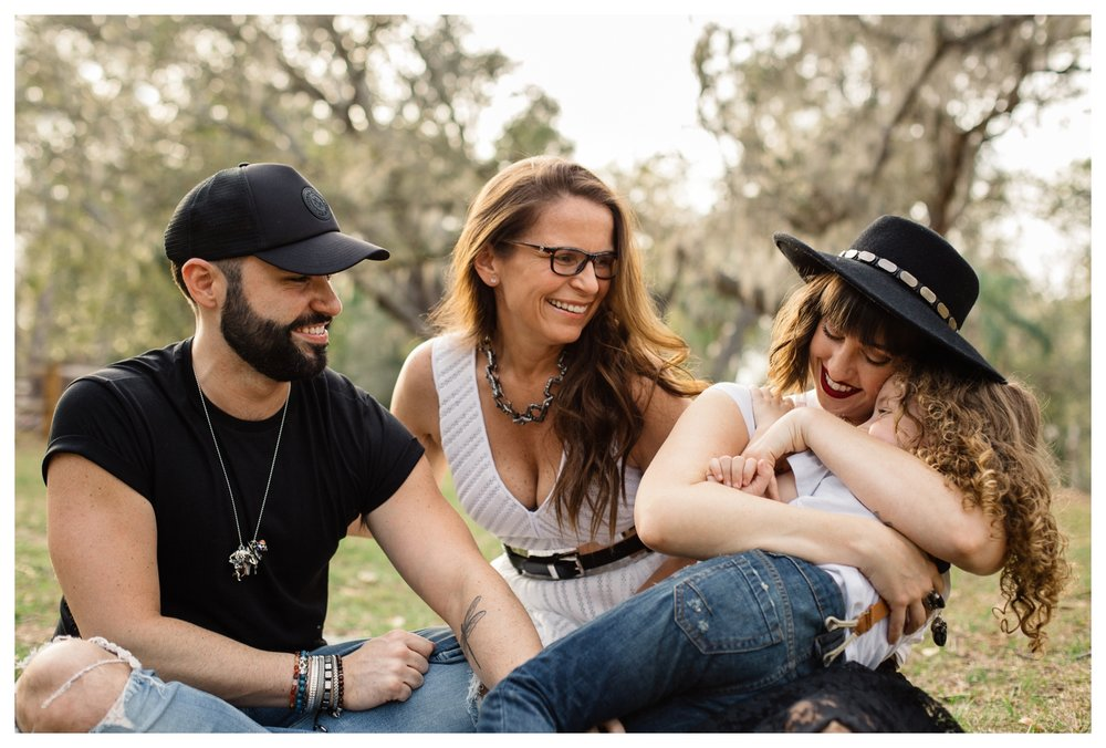 Family Sitting in Grass at Mead Botanical Garden Lifestyle Family Photographer Winter Park.jpg
