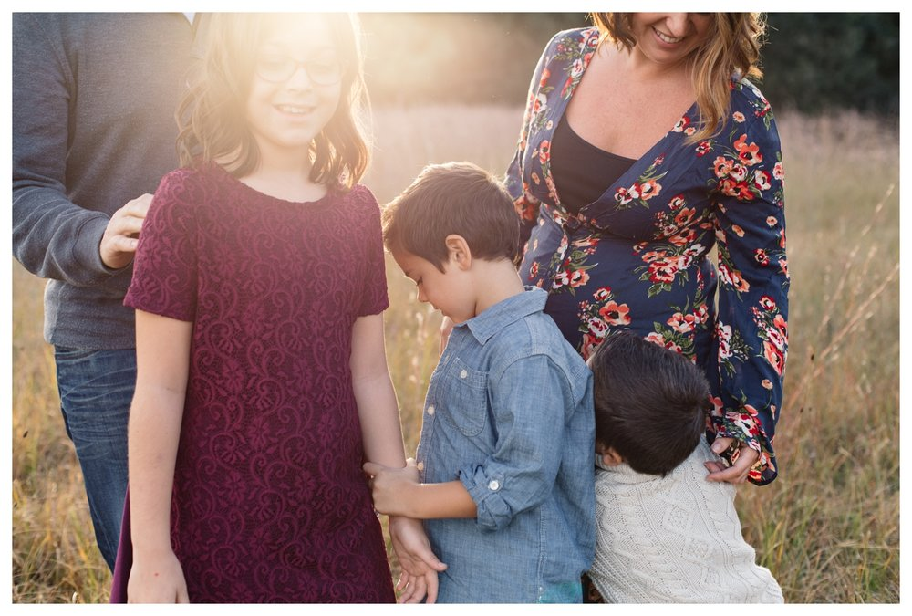 Candid Family Photo in Field at Sunset Orlando Lifestyle Photographer.jpg