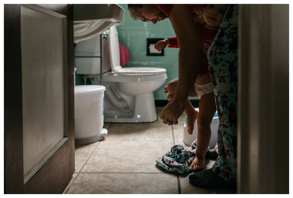 Dad Helping Toddler in Retro Bathroom Orlando Documentary Photographer.jpg
