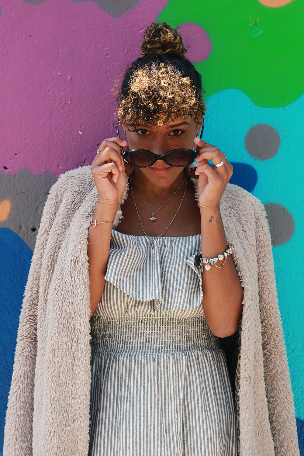 Coat: Kenneth Cole; Dress: Zara; Sunglasses: Chanel; Necklace: Forever21; Bracelet (Left): Paul Hewitt; Bracelet (Right): Pandora; Photography by Nikki Price