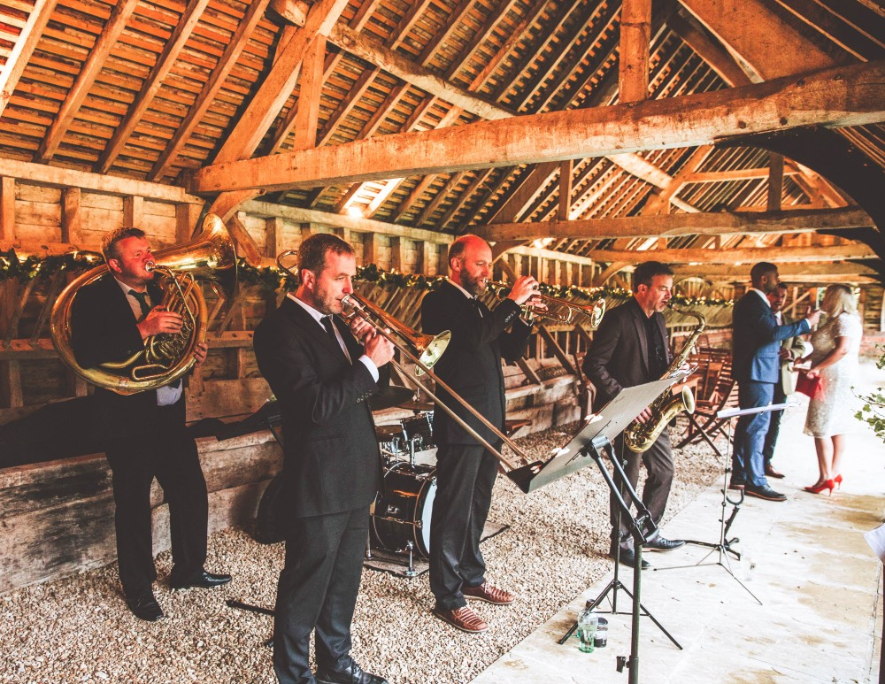 brass junkies live on stage at barn wedding in Wales