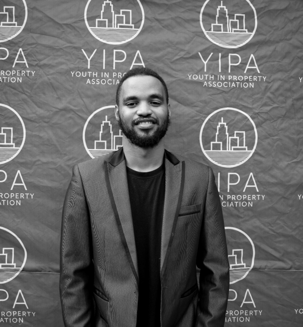 """Tumelo Bopape - Project Manager: YIPA Junior   Tumelo has been an active member of YIPA since its launch in 2017. Through his role as Project Manager of YIPA Junior, he aims to increase the awareness of high-school students on property and provide opportunities for them in the property sector.   He is passionate about property and aspires to start a property development and investment company.   """"Building generational wealth is important for our growth and significance in this world. The time to build is now"""" says Tumelo"""