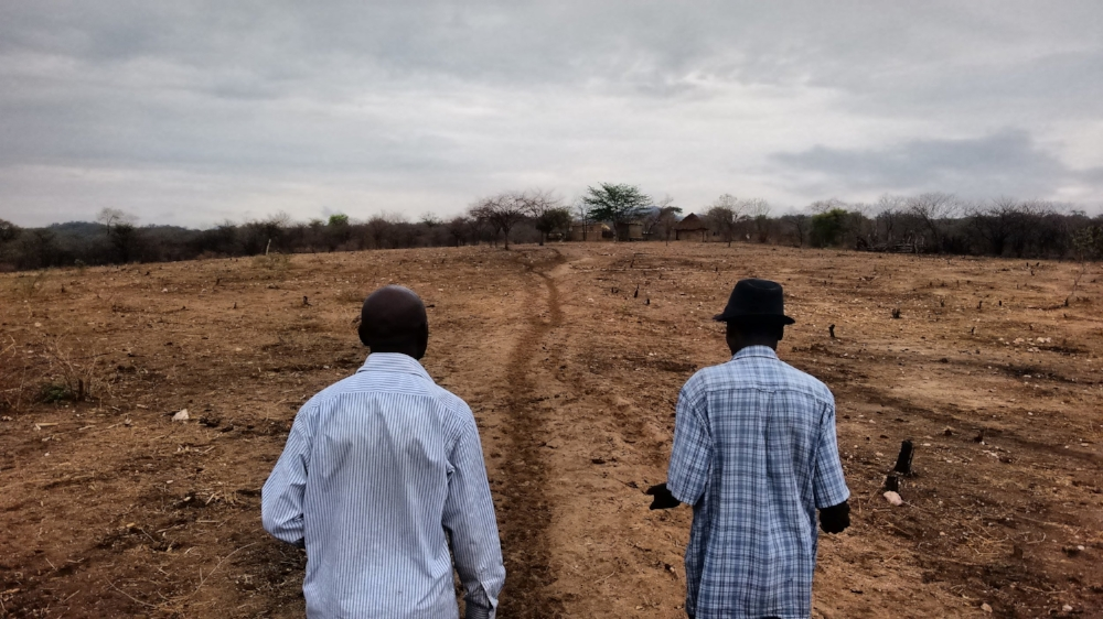 Ngoni Kadondo (left) and Isaac Kufandirori (right) walking towards Isaac's home in Nyamanyanya near Marymount Mission, Northeast Zimbabwe. Photo by Zack Moon.