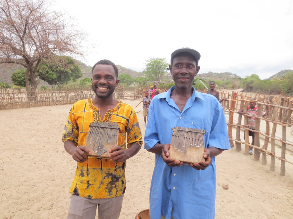 Kudakwashe Nyaruwabvu (left) and Shorai Katsukunya (right) holding madhebhe mbira