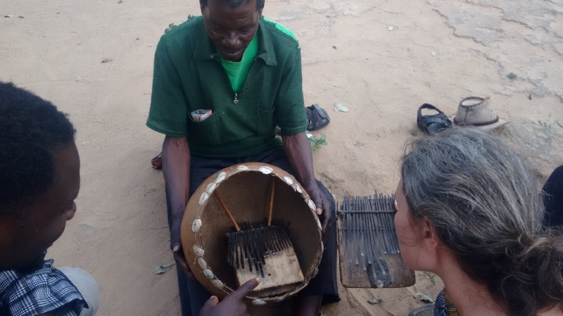 Masarakufa shows us the madhebhe he built in 1968. Kuda and I compare his mbira to Partson Nyaruwabvu's madhebhe on the right.