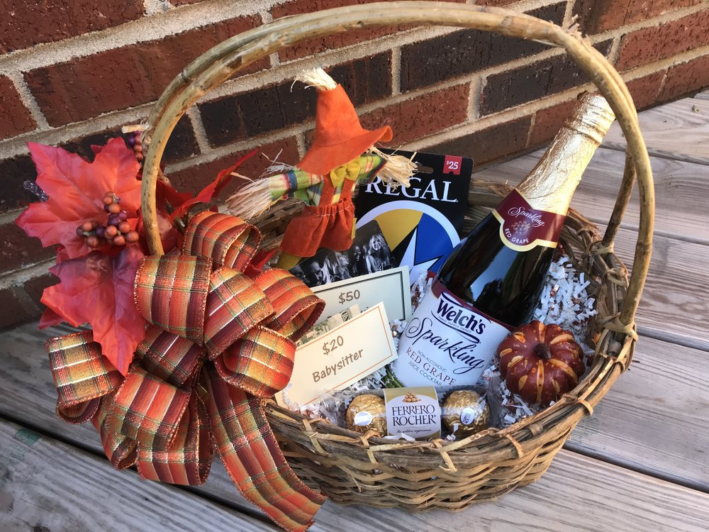 PARENTS' MOVIE NIGHT OUT   No expense left unnoticed in this Parents' Night Out basket! Enjoy $50 for dinner or drinks at Bar Louie, $25 for a movie at Regal, $20 towards a babysitter, and a bottle of Sparkling Red Grape Juice (non-alcoholic) to enjoy with Ferrero-Rocher Chocolates for dessert.  DONOR: 5th Grade Classes VALUE: $100