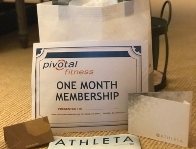 """I WORKOUT"" GYM BAG   Stay fit and looking great with this gym workout collection. Included are one-month Pivotal membership, $50 Athleta gift card and $15 Starbucks gift card in an Athleta carry all bag.  DONOR: 3rd Grade Classes VALUE: $115"