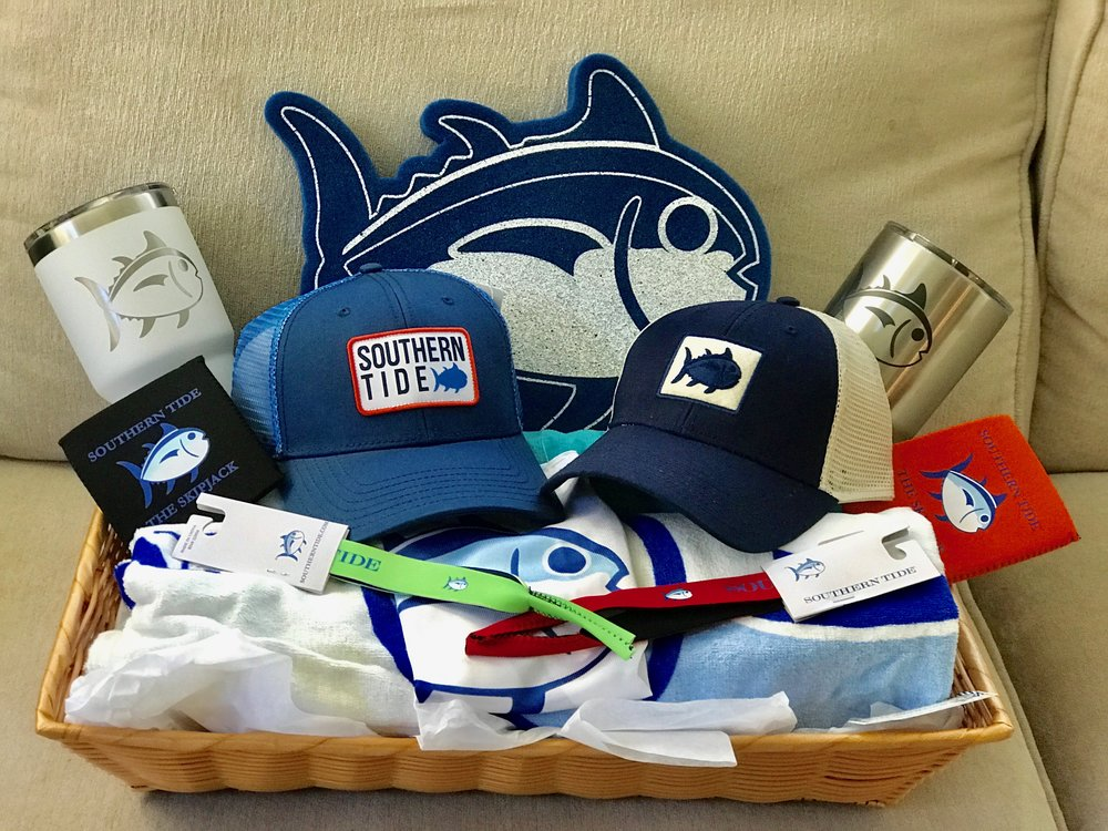 SOUTHERN TIDE BASKET A OR B   Do you like an affinity for all things BLUE and don't show away from making a statement? Then one of these Southern Tide baskets are for you! Included are Southern Tide beach towel, trucker hat, Yeti 30oz Rambler, can caddie, sunglass strap and Skipjack foam mitt.  DONOR: Southern Tide VALUE: $145 Each