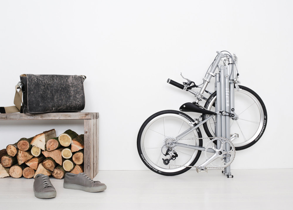 Whippet Bicycle - folded next to bench