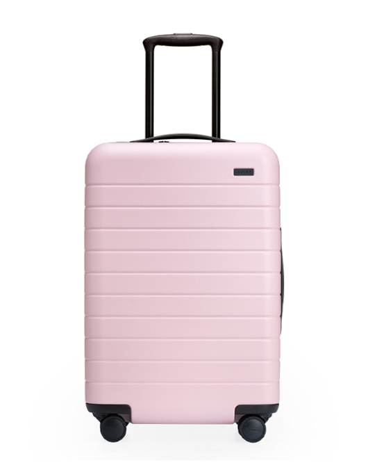 Away Luggage   - This carry-on is the perfect piece for the modern traveler, as it has a built-in battery and USB port, so you'll be able to check all of your devices (think city maps, tickets, emails) when you're on the go.To buy:  West Elm, $225