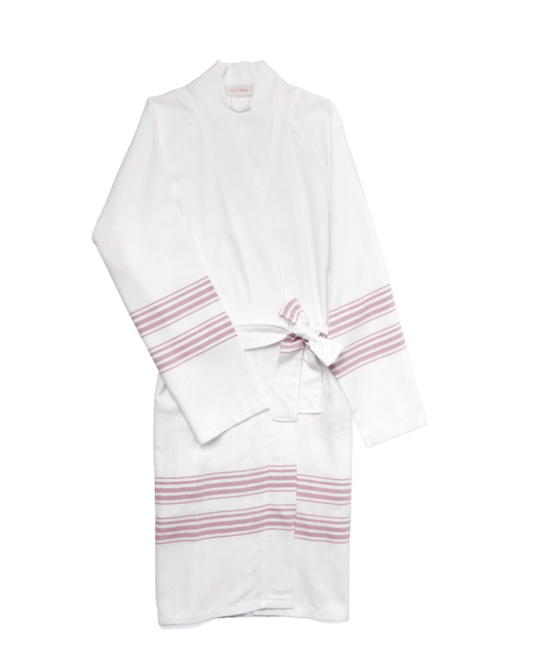 Cuyana Turkish Cotton Robe - Poolside, seaside or just out of a relaxing bath, this robe has lounging down to an art. Woven of soft, ultra-luxurious Turkish cotton and premium bamboo, it's lightweight, quick to dry and easy to pack. Whether indoors or out, from season to season, you'll always be sitting – lounging – pretty.To buy: Cuyana, $95