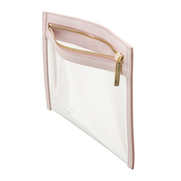 Truffle Clarity Clutch - This small, transparent clutch with luxe leather trim and gold plated hardware, its a chic option to carry alone or toss in your handbag. Its TSA approved size also makes it the perfect companion for any carry-on. I always travel with both the small and large size and love how organized they keep everything!To buy: Truffle Co., $45