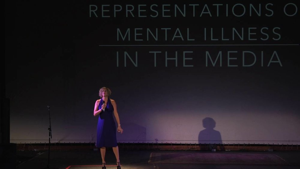 Chrissie Hodges presenting at Ignite Denver on 'Myths about Mental Illness'