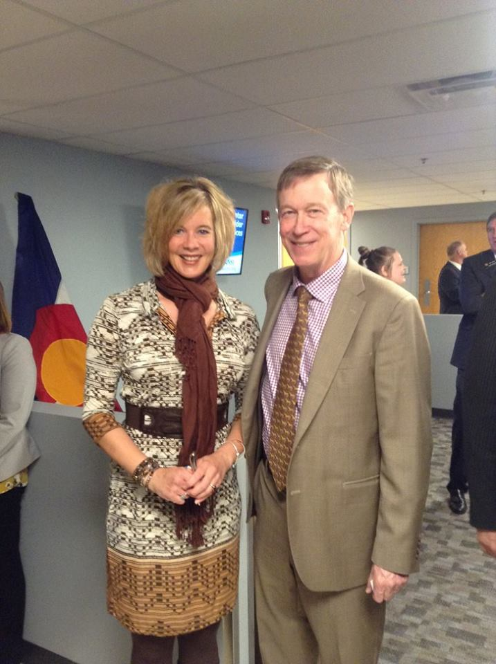 Chrissie Hodges with Colorado Governor Hickenlooper at the signing of Senate Bill 207 keeping individuals with mental illness from being held in jails.