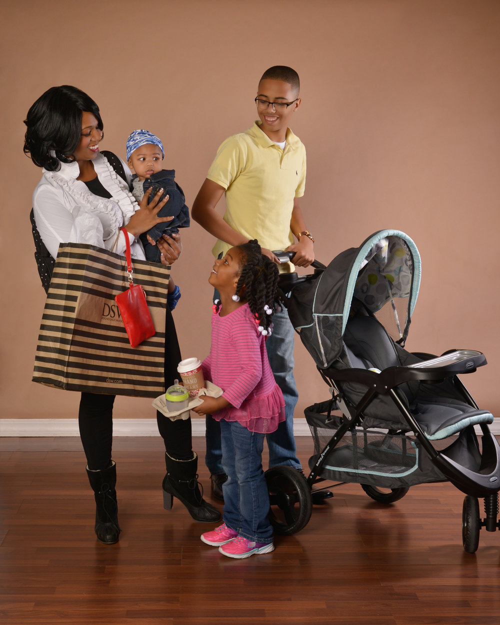 LUX Baby Founder/CEO Lisa Hyche, along with three children, Meciah, London and baby Myles.