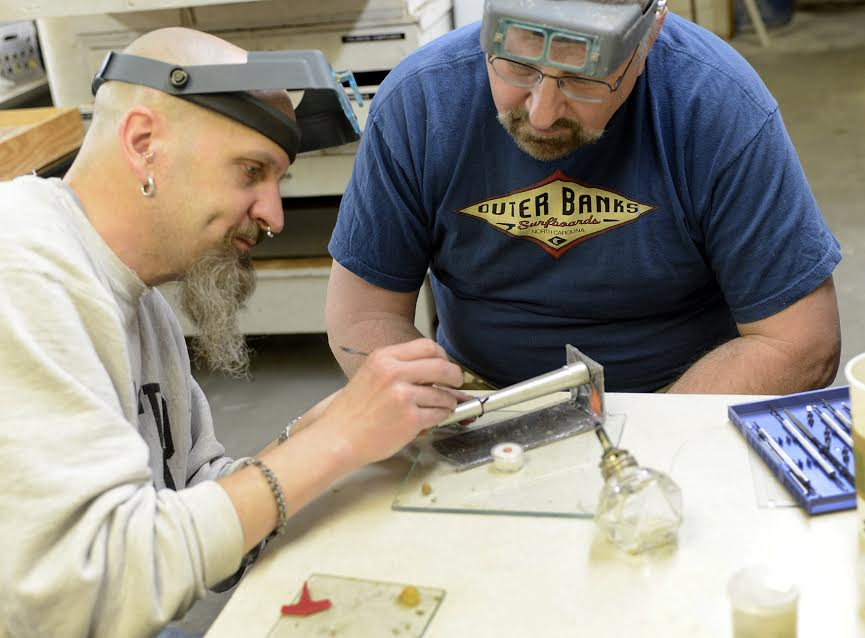 Eric (on left) teaching a lost-wax casting class
