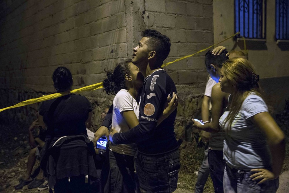 A boy mourns his brother, assassinated in a neighborhood,  of Tegucigalpa, capital of Honduras.
