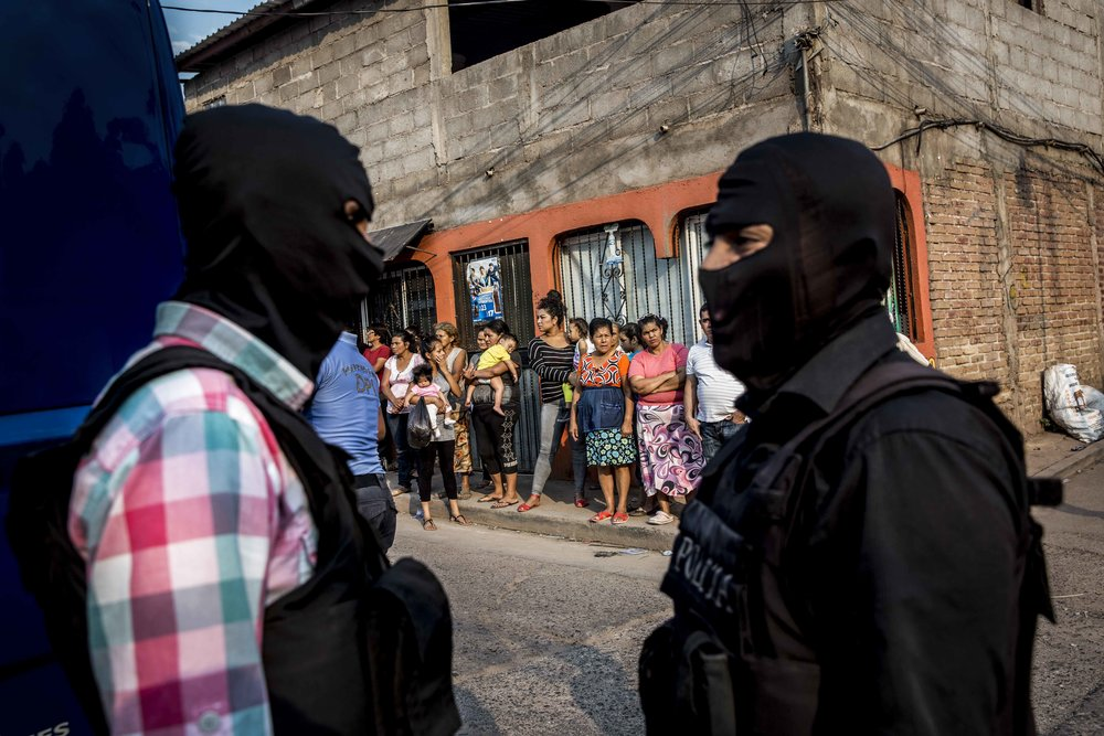 Police on the site of the murder of two brothers, Carlos Amador 22, and Edwin Amador, 20, murdered in cold blood in the streets of the Suyapa district, Teguciaglpa, capital of Honduras.