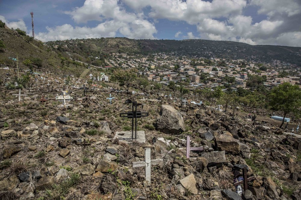 "The cemetery in the settlement colony called ""Divino Paraíso"" (Divine Paradise) in the capital Tegucigalpa, one of the most dangerous neighborhoods because under control of M-18 street gang. In this cemetery many gang members are buried."