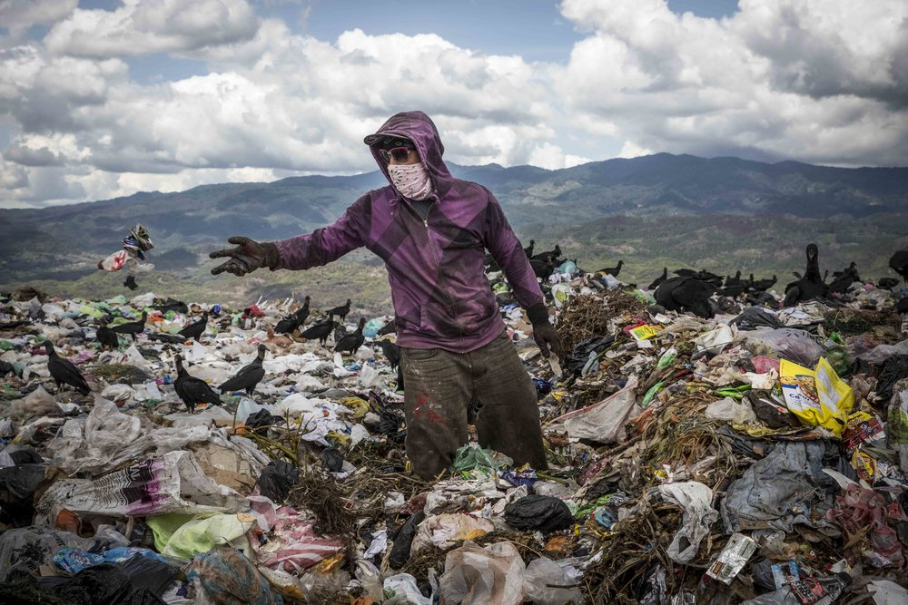 A boy searches for plastic material,  in the main landfill in Tegucigalpa, which is under control of the local gangs. Everything is then sold for a few US dollars and in this way many make their living.