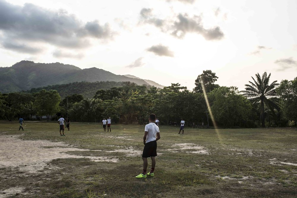 Young men in the football field of the Guadalupe Carney community, outside the city of Tocoa in the department of Colon, Aguan valley, on the Atlantic coast of Honduras. Insecurity in the Aguan valley has an active role in displacing people from their lands, especially young people and drive them to the major cities of Tegucigalpa and San Pedro Sula, where they often meet financial insecurity and end up join either Mara Salvatrucha (MS-13) and 18 Street Gang (M-18), the two most important street gangs in the city.