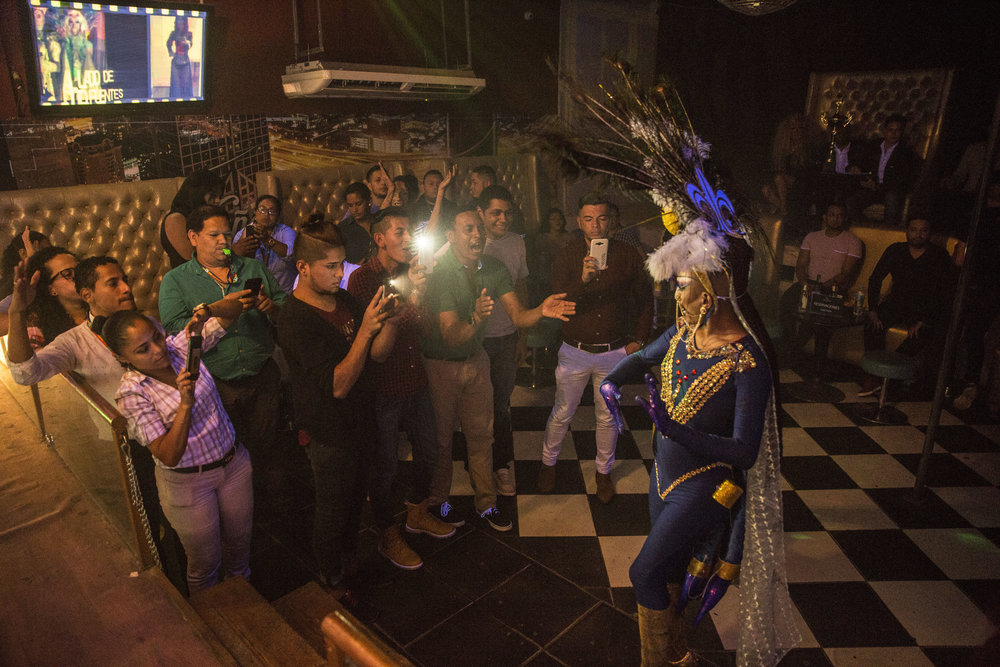 People show their support to their companion Diva Zuraika, during a beauty contest in gay club in Tegucigalpa, capital of Honduras.