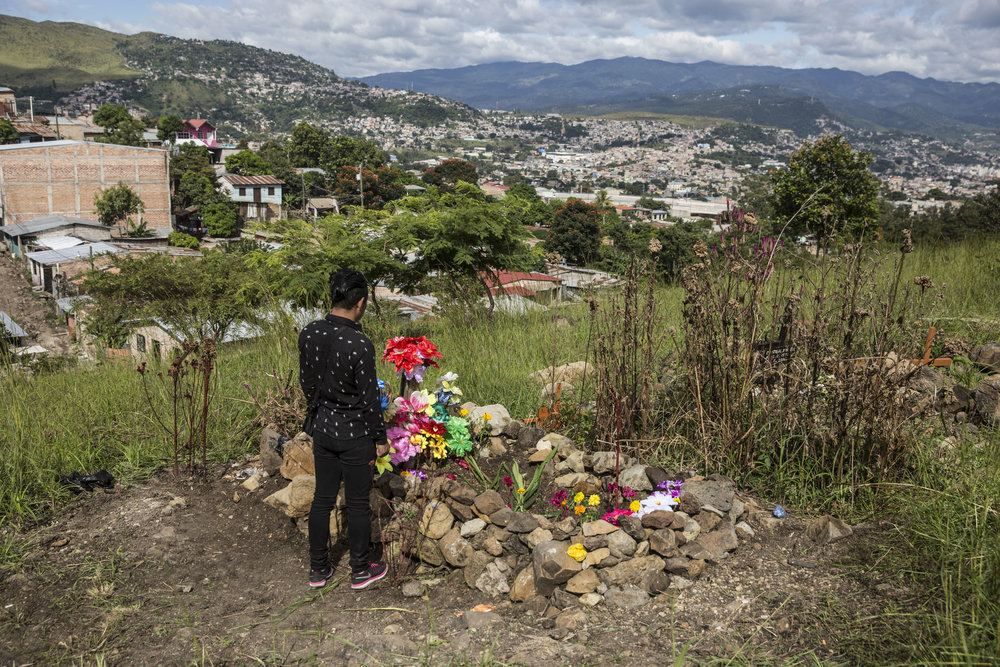 Darwin at his brother's grave overlooking Tegucigalpa, the capital of Honduras. Darwin is not safe, he has been threaten by the same gang that murdered his brother. In 2017, there have been 34 murders of LGBT community members in Honduras, according to the observatory on violent deaths of the organization Cattrachas.