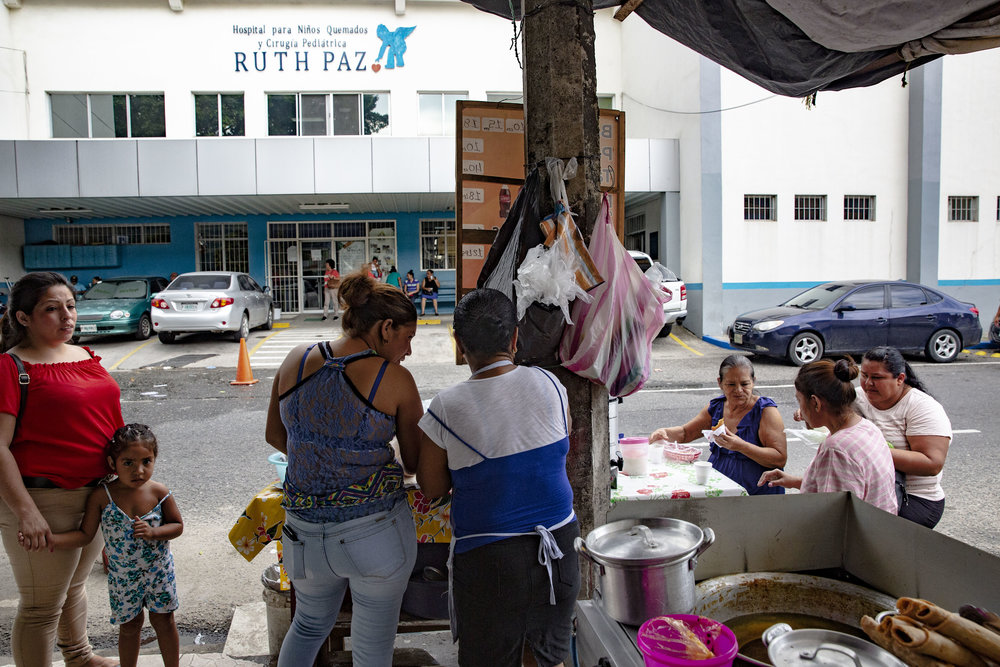 Women preparing and selling tradional honduran food for breakfast outside the Ruth Paz hospital in San Pedro Sula, Honduras.