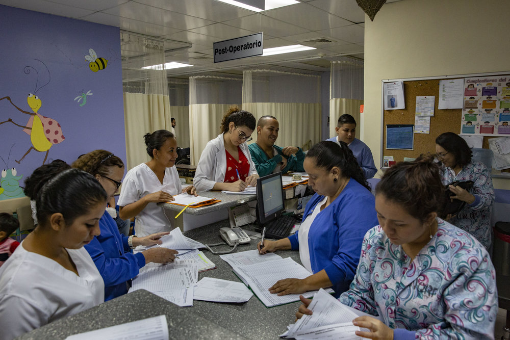 Nurses and doctors inside the Ruth Paz hospital. The doctors work at the clinic for a symbolic sum for some days of the week.