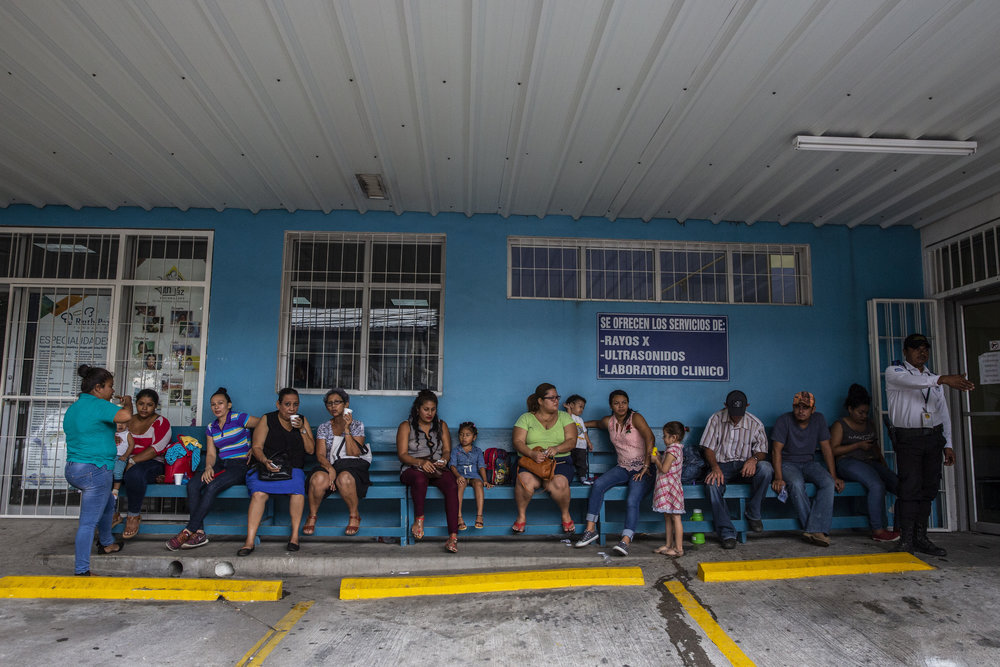 Early morning queue of people waiting outside the Ruth Paz hospital in San Pedro Sula, Honduras.