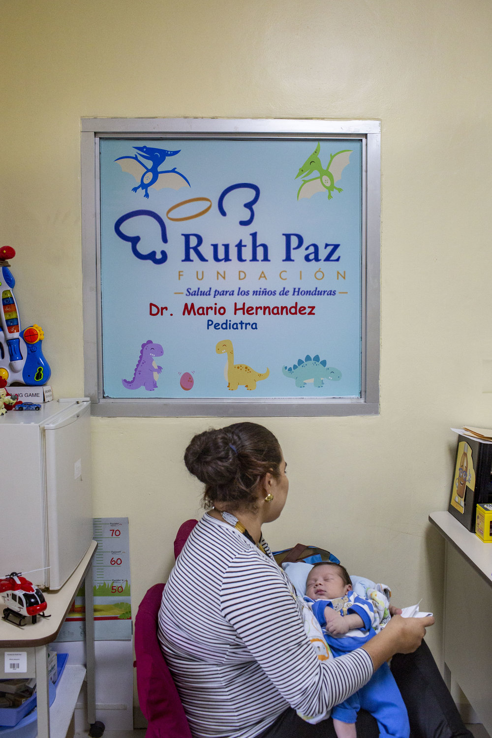 A mother gets his son checked up by a pediatrist at the Ruth Paz hospital in San Pedro Sula, Honduras.