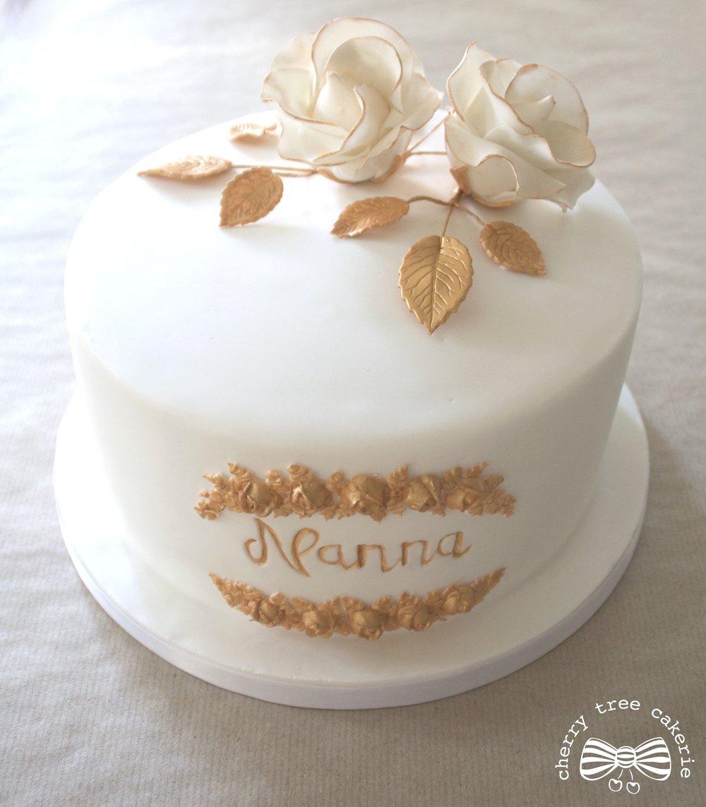White-and-gold-sugar-rose-birthday-cake