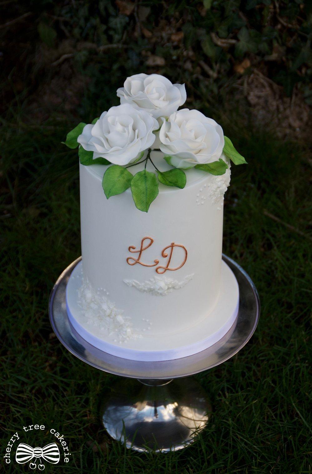 White-sugar-rose-monogrammed-wedding-cake