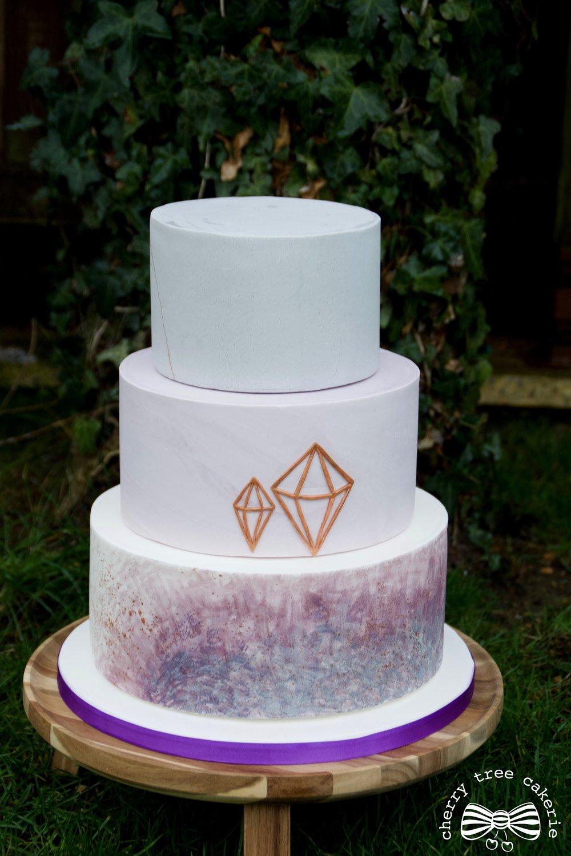 Geometric-marbled-ultra-violet-wedding-cake