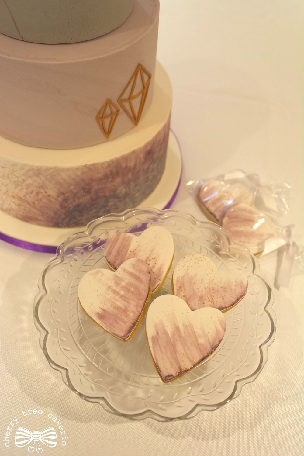 Ultra-violet-and-bronze-hand-painted-wedding-biscuit-favours