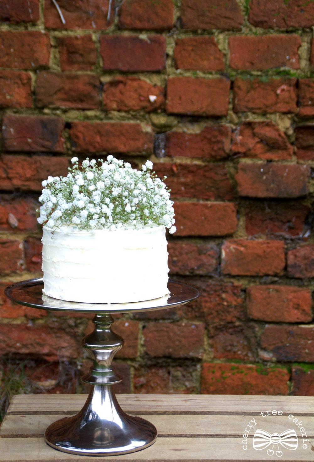 White-buttercream-wedding-cake-with-gypsophila