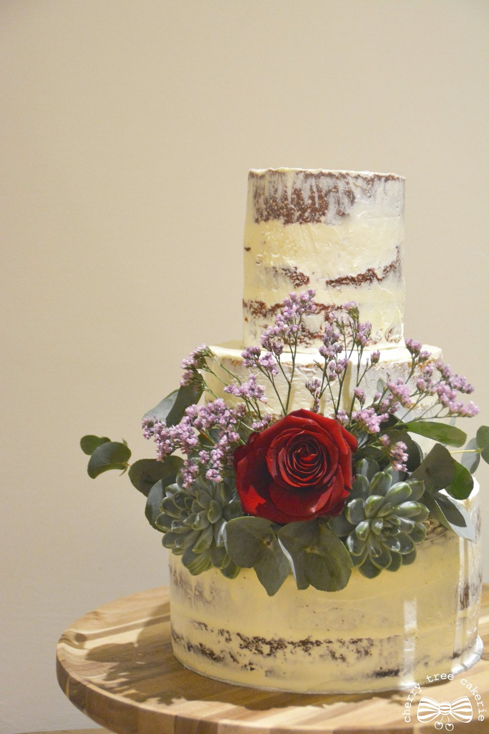 Semi-naked-rustic-wedding-cake-with-rose-and-succulents