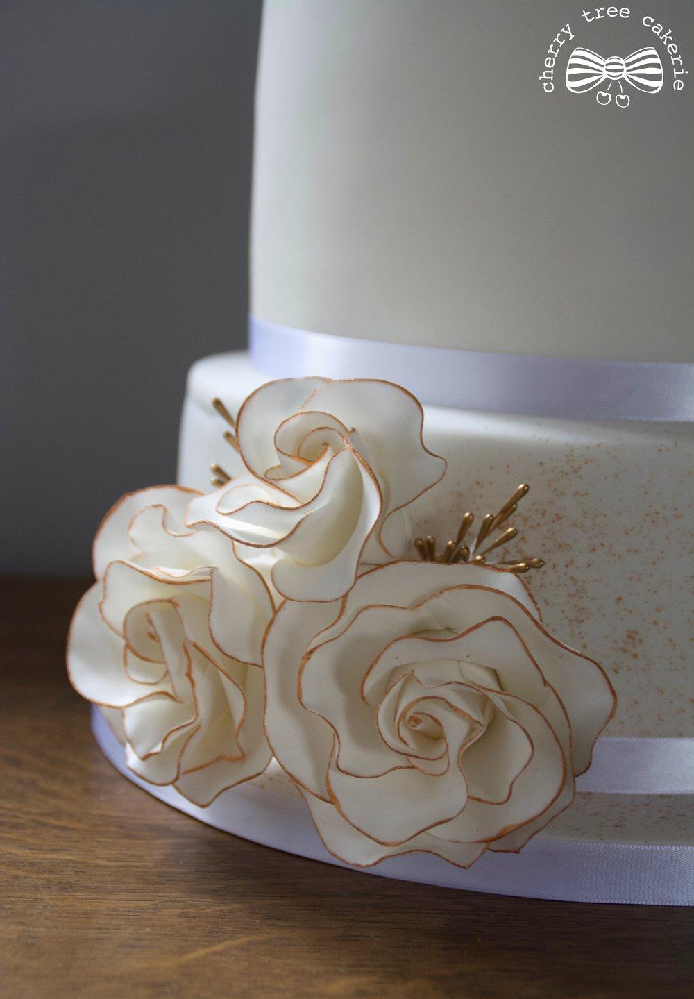 Gold_and_white_rose_wedding_cake_bottom_view.jpg