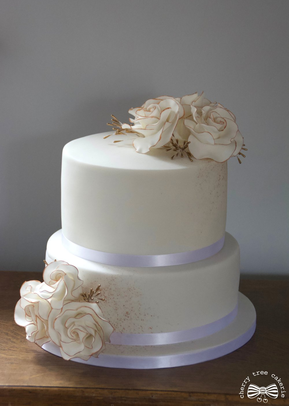 Gold_and_white_rose_wedding_cake_whole_view.jpg