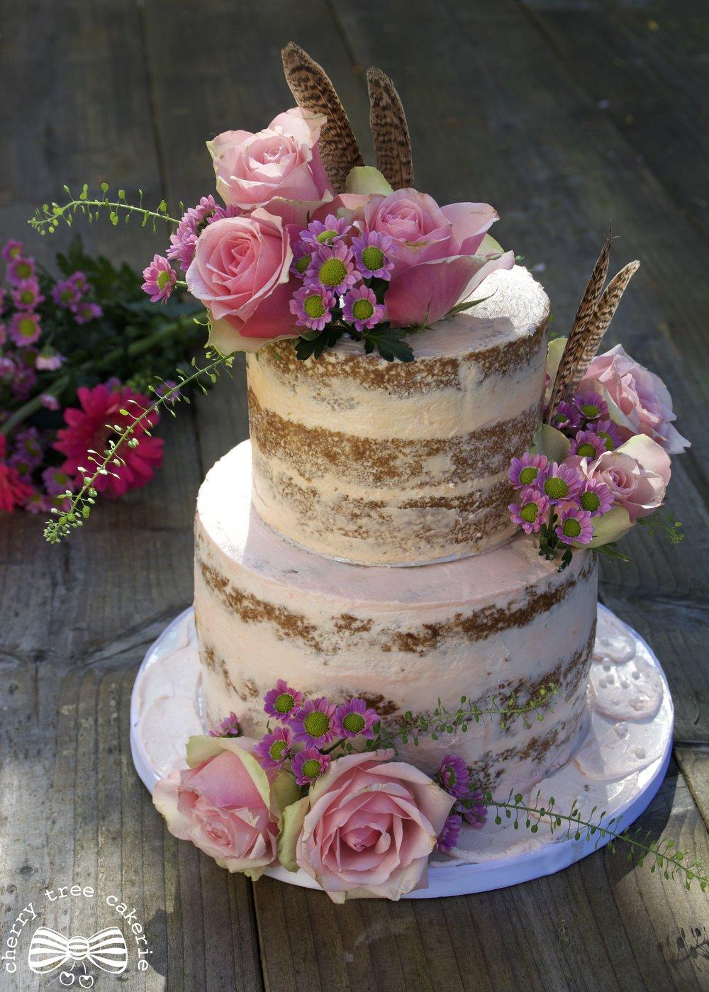 Seminaked wedding cake purple florals full.jpg
