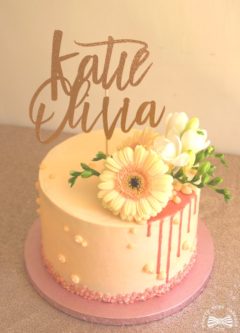 Peach and rose gold drip cake.jpg