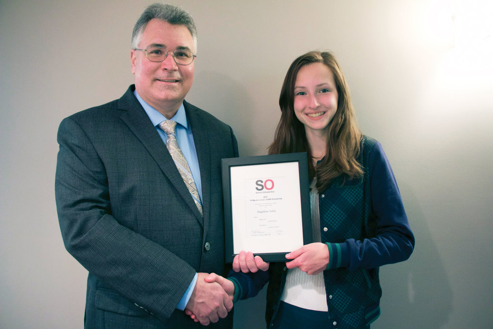 Magdalena receives her Scholarship certificate from Dr. Semco!