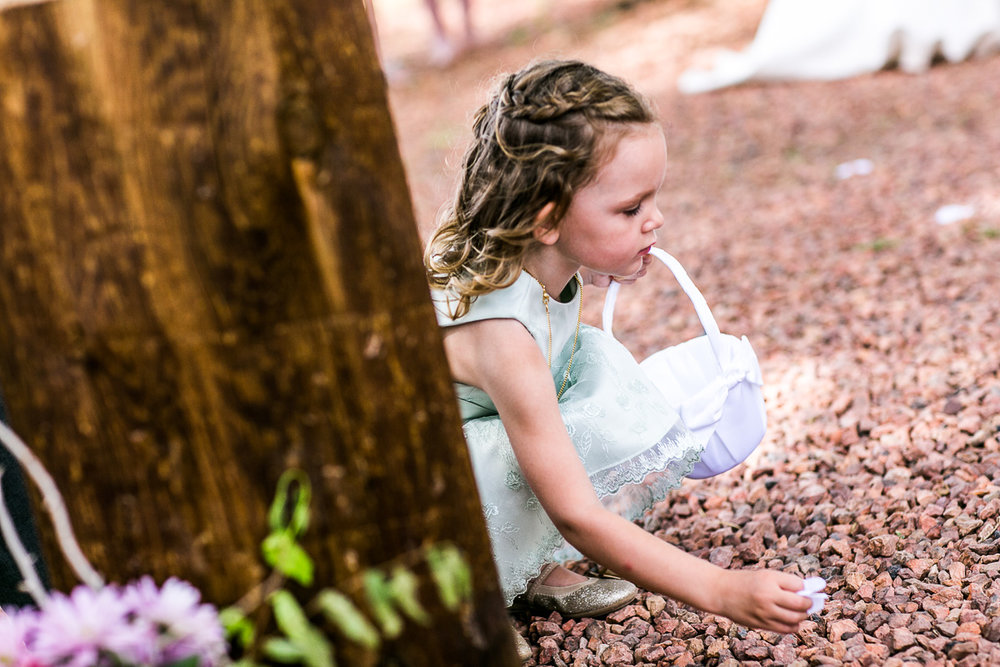 Careful petal placement by the flower girl