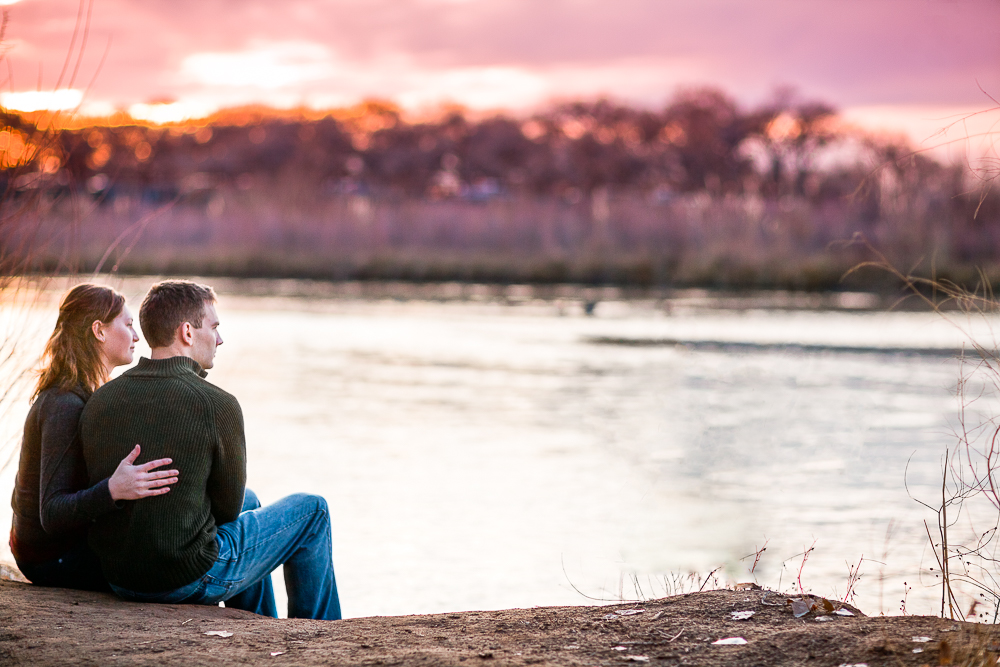 Sunset engagement moment, overlooking the water