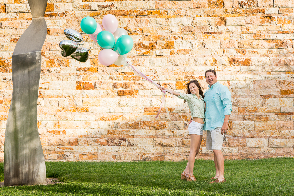 JC & Gaby having fun with balloons at their engagement session