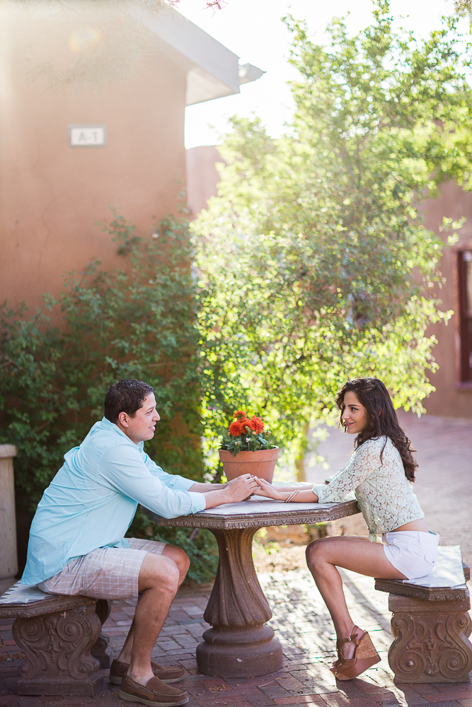 Sweet red flowers and a courtyard engagement session