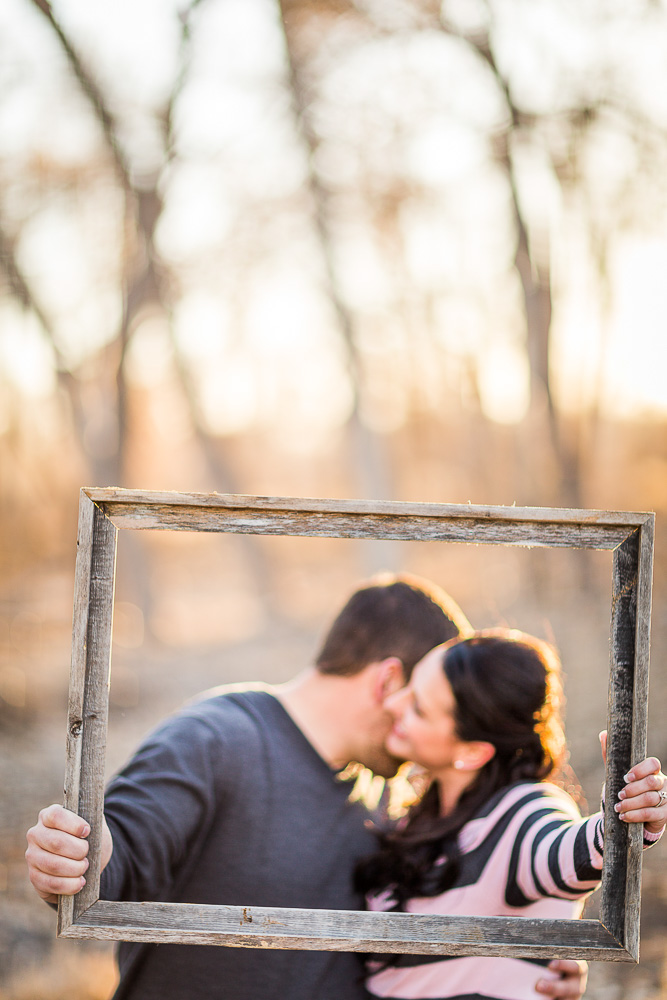 Kristy & Jeremy frame this engagement photo with a rustic look. - Love Springs Studios