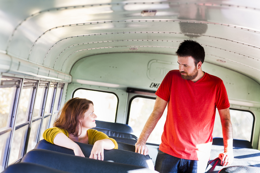 Sean & Andrea got on this sweet School bus for some of their engagement photos and had a blast! - Love Springs Studios