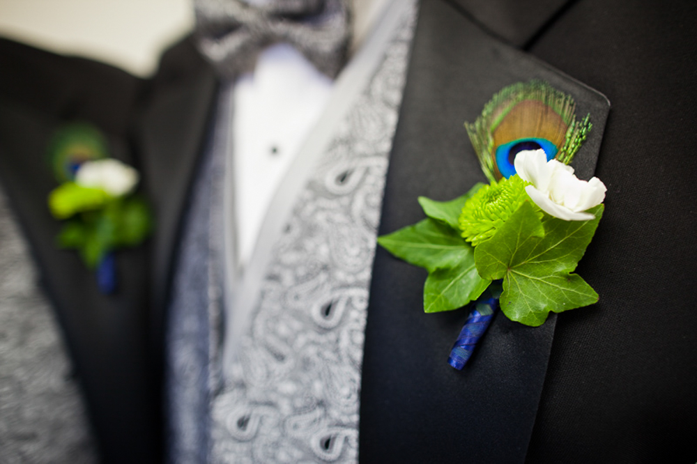 Peacock feather details for the groomsmen