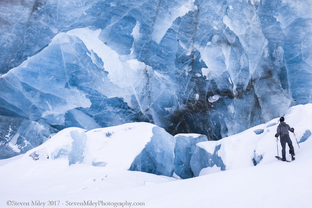 A crumbling wall of blue glacier ice at the terminus of Canwell Glacier.